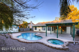 Very large back yard featuring an expanded covered patio, pool and spa.