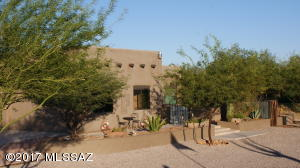 a 2+acres ranchette, with private backyard becomes your own Oasis in the Desert