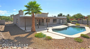 You need to see this manicured landscaped private acre in person! Pebble tec self cleaning pool.