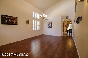 Enter into elegant spaciousness w/soaring ceilings.