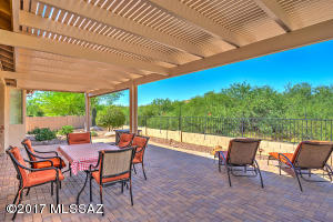 Peaceful private patio and yard opens to natural space. Enjoy watching the abundant wildlife passing by.