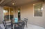 Deep Covered Patio with Lighting is the Perfect Spot for Outdoor Dining and Enjoying the Views and Privacy at this Home.