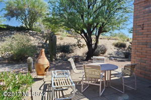 Private and tranquil backyard. Backs to natural desert.