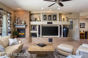 Media center w/niches, stacked rock 2-way gas fireplace, ceiling fan, lovely tile, decorative niches.