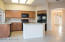 Updated kitchen with brand new cabinets, granite counters, appliances and fixtures.