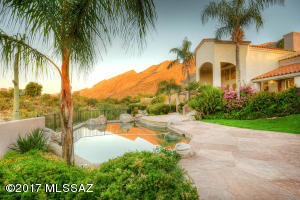Lush landscaping gives the feel of a oasis in the desert. Welcome home!