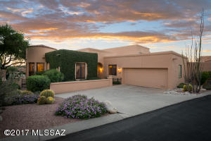 Located in the coveted Paloma del Sol neighborhood in guard gated La Paloma. Exceptional Townhome w/ over 3200 sf