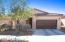 Front of home. Custom metal garage door- garage extended 4'