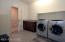 Large Laundry room with cabinet - entrance from Garage.