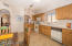 Kitchen has newer gas stove, built in microwave and good size refrigerator with convenient bottom freezer.