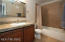 Update Master bathroom with newer cabinets, granite tile and fixtures.