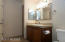 Updated Hall Bathroom with newer cabinets, fixtures and granite tile.