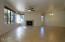Great Room with Fireplace/Dining room area. Backs to grassy common area.