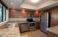 Remodeled Kitchen w/ granite tile counters newer cabinets and appliances.