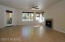 Great Room with patio door to small covered patio area backing to common area.