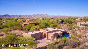 """This beautiful custom home (3859 sqft) enjoys the privacy of a large lot (1.18 acre), back a long driveway, in a gated community in the """"heart of Oro Valley""""."""