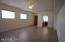 Large great room looking toward front door and kitchen