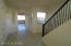 Entry way/ Wrought iron stairway banister