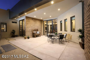 A great look at the front entry courtyard with covered spaces for enjoying evening sunsets.