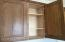 Madera Mesquite cabinets. Boxes are all plywood with solid oak frames, doors and drawer fronts with a Mesquite finish.