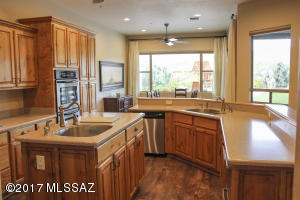 Gourmet cooks kitchen delight with 2 full sinks, double ovens, and a gas cooktop.