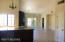 Dishwasher and more cabinets under counter, breakfast bar on other side. View to family room