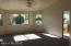 Master bedroom with garden views and vaulted ceilings