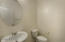 Powder room, directly off the front hallway for easy access to guest
