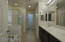 Large walk-in shower with glass enclosure and garden tub for relaxing and enjoying your space