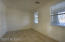 Huge space in the lower floor for a guest room, den space or a home office with lots of windows and solid wood french doors.