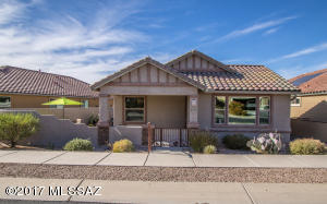 Adorable 2 bedroom home with custom courtyard enclosed by stucco wall is a perfect home for care-free living.