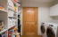Pantry/Laundry/Utility Room with wall of storage