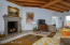 Greatroom w/wood burning fireplace & wood beam cathedral ceilings