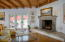 Beautiful wood burning fireplace, French doors to pool & outdoor space