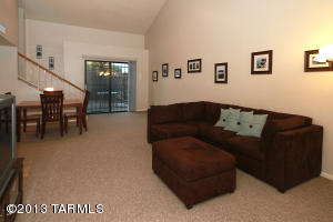 Open and inviting greatroom welcomes you. Soaring ceilings, neutral carpeting and great floorplan.