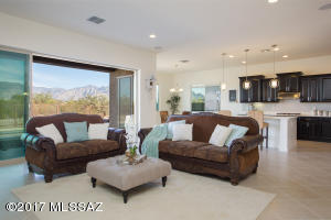 Great Room with Three Pane Sliding Doors to Covered Patio and Mountain Views