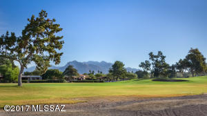Watch the golfers head to the 14th green & take in the mountains from your private patio