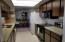 Great galley kitchen with ample cabinets and pantry. Very nice appliances!