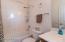 Guest bath shower/tub combo.