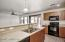 Kitchen features Island with Breakfast bar, beautiful cabinets, all appliances included!