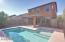 Pool surrounded by easy care yard space