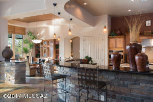 Wrap Breakfast Bar with Cultured Stone, and Pendant Lighting