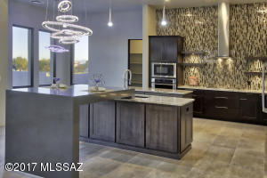 Quartz waterfall peninsula, 2nd prep island, glass mosaic to ceiling, designer two-toned Shaker style maple cabinetry w/contemporary stainless hardware.