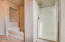 separate shower and large garden soaker tub with plant shelves in master bath