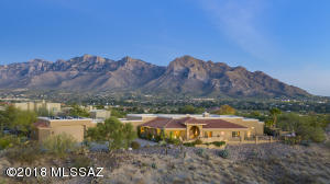 Gated Canada Hills Estates single story 3,495sf 3BR/2½BA w/unobstructed panoramic Catalina Mountain views from inside & out. Car collector's garage will hold 10 +/-cars w/innovative two-tier parking and/or RV
