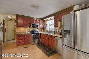 newer appliances in kitchen with garden window and eat in area