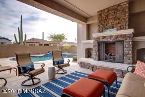 Enjoy your own personal oasis complete with outdoor fireplace and inviting pool with great landscape