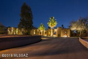 Front of Home with Paved Driveway, professional landscape lighting.