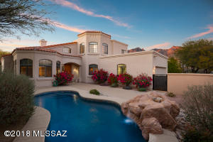 Five bedroom home with pool located within guard gated and highly desirable La Paloma, Tucson's premier central foothills country club and resort area.
