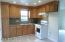 Gas cook top and oven. Double, stainless steel sink and upgraded cabinets !